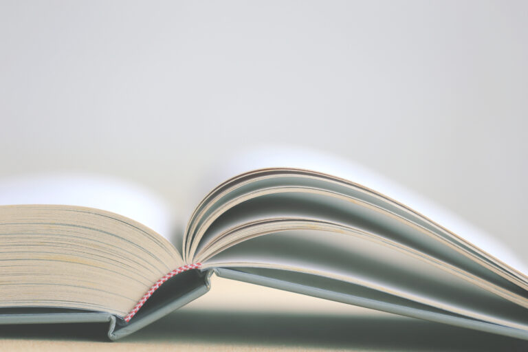 Close up picture of an open book on a table